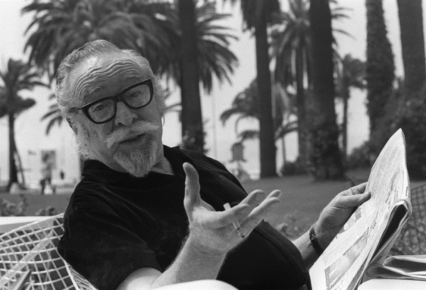 """CANNES, FRANCE:  American movie director Dalton Trumbo pose for photographer 17 May 1971 in Cannes as he presents his latest movie """"Johnny Got His Gun"""". Trumbo (1905-1976) was a victim of the anti-Communist witchhunt campaign instigated by John Parnell and Senator Joseph McCarthy between 1947 and 1954. In 1947 Trumbo was condemned by the HUAC (House Un-American Activities Committee) along with nine other Hollywood personalities. The group is known as the """"Hollywood Ten"""". In the 1960's Trumbo could work again under his real name thanks to the intervention of actor Kirk Douglas. (Photo credit should read AFP/Getty Images)"""